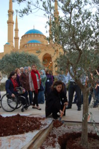 Planting the tree at the Garden of Forgiveness