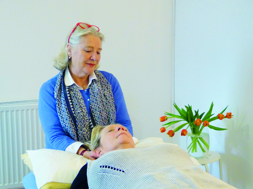Craniosacral practitioner Caroline Lawrence at work