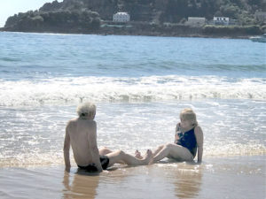 Alastair and Marilyn play on the beach in Jersey