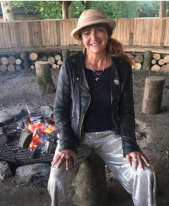 Supervising Hoffman facilitator Emma Ferguson by firepit at Broughton Hall